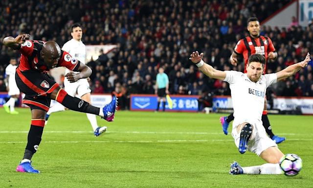 "<span class=""element-image__caption"">Benik Afobe fires in a shot for Bournemouth's second goal against Swansea.</span> <span class=""element-image__credit"">Photograph: TGSPhoto/Rex/Shutterstock</span>"