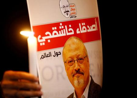 FILE PHOTO: A demonstrator holds a poster with a picture of Saudi journalist Jamal Khashoggi outside the Saudi Arabia consulate in Istanbul