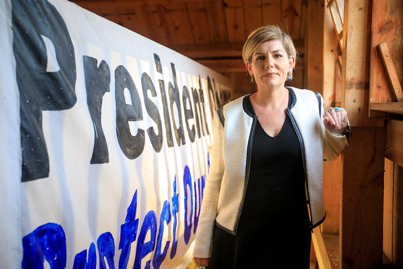 Jane Kleeb, chair of the Nebraska Democratic Party and activist against the Keystone XL pipeline, poses on Sept. 19 at a solar barn she helped build. The barn sits along the proposed path of the Keystone XL pipeline in Bradshaw, Nebraska.