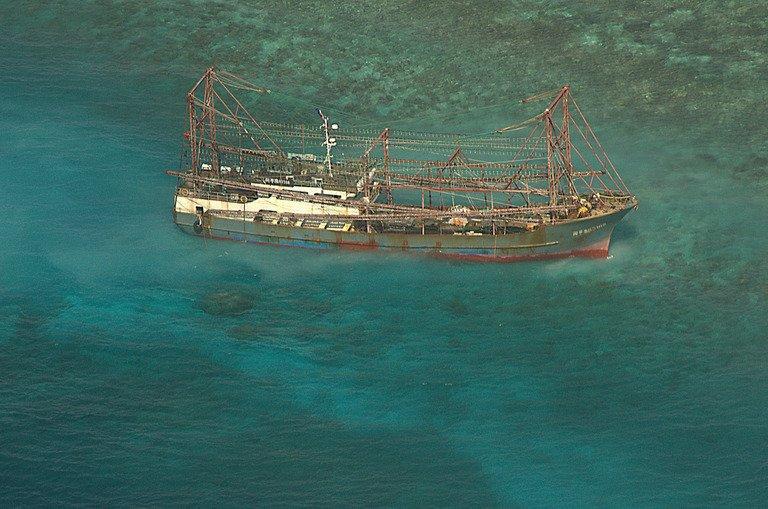 A Chinese fishing boat sits on the Tubbataha reef, in Palawan island, western Philippines, April 10, 2013