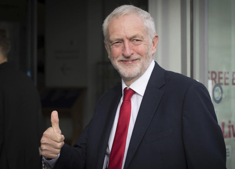 Britain's main opposition Labour Party leader Jeremy Corbyn gives a thumbs up gesture as he arrives for an interview by BBC TV journalist Andrew Marr, in Liverpool, England, Sunday Sept. 23, 2018. The Labour Party is holding its annual party conference in Liverpool, which is due to decide on decisive issues like whether to back a new Brexit referendum on the country's departure from the European Union. (Stefan Rousseau/PA via AP)