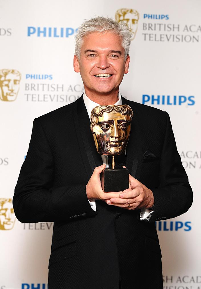Phillip Schofield with the Entertainment Programme award received for The Cube at the Philips British Academy Television Awards at the Grosvenor House, 90 Park Lane, London. (Photo by Ian West/PA Images via Getty Images)