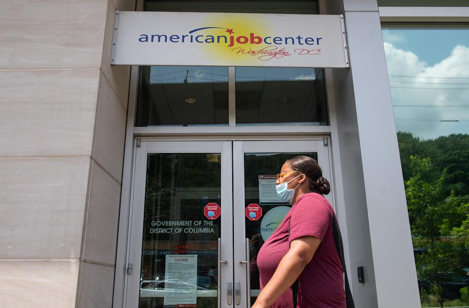 A woman walks past the the DC Department of Employment Services American Job Center, which assists in finding employment for out of work DC residents, in Washington, DC, July 16, 2020. - Americans worry as unemployment benefits are due to end soon. (Photo by SAUL LOEB / AFP) (Photo by SAUL LOEB/AFP via Getty Images)
