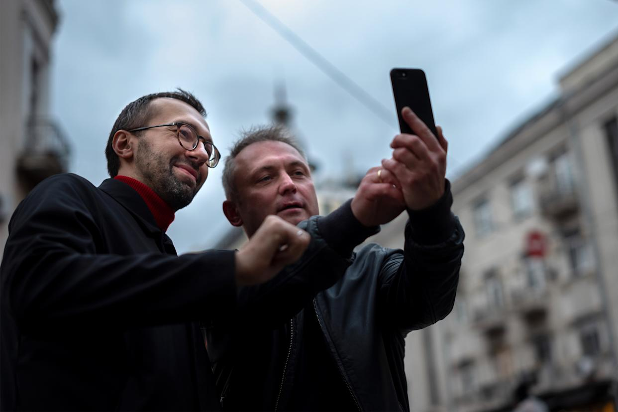 A supporter of Serhiy Leshchenko, takes a selfie on the street in Kyiv, Ukraine on October 29, 2019. (Photo: Agron Dragaj for Yahoo News)