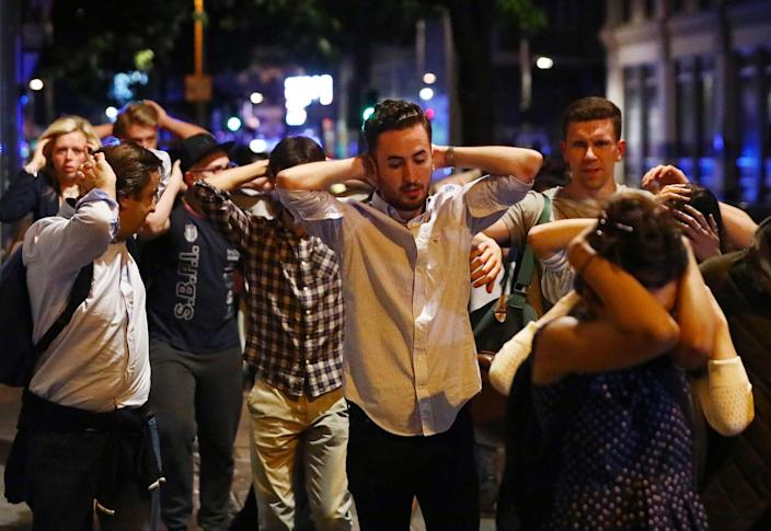 <p>People leave the area with their hands up after an incident near London Bridge in London, Britain June 4, 2017. (Neil Hall/Reuters) </p>