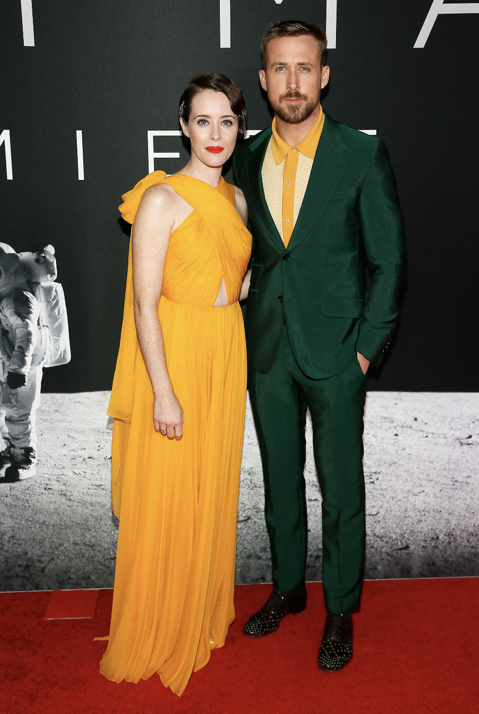 <p>On 4 October, Claire Foy won in the style stakes yet again as she stepped out in a yellow gown by Oscar de la Renta to attend the 'First Man' film premiere in Washington DC, USA. Ryan Gosling matched her dress with a bright yellow polo shirt, worn under a green satin suit. <i>[Photo: Rex]</i> </p>
