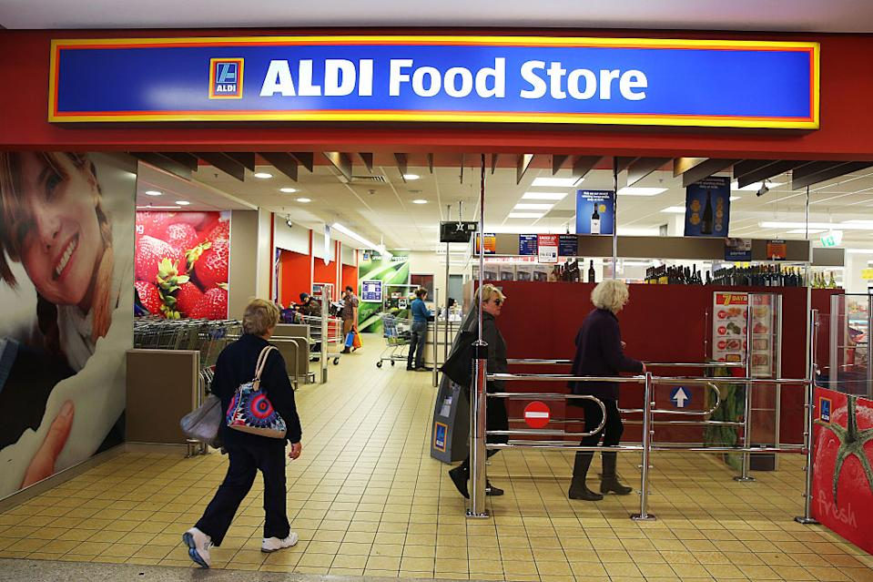 An Aldi store in Australia with three shoppers entering.