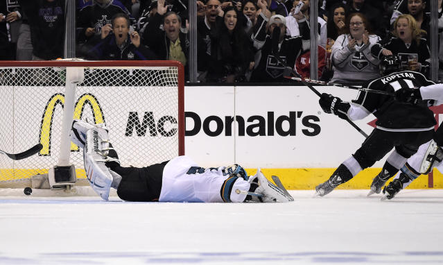 Los Angeles Kings center Anze Kopitar, right, of Slovenia, scores on San Jose Sharks goalie Alex Stalock during the third period in Game 6 of an NHL hockey first-round playoff series, Monday, April 28, 2014, in Los Angeles. The Kings won 4-1. (AP Photo)
