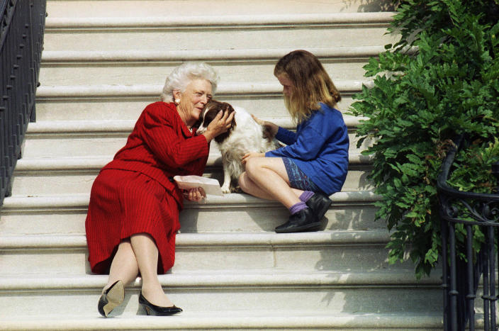 FILE - In this Sept. 13, 1991, file photo, first lady Barbara Bush, her granddaughter Barbara, and Millie wait on the steps of the White House for President George H.W. Bush to return from his check-up at Bethesda Naval Hospital in Washington. Pets are back at the White House. President Joe Biden's German shepherds Champ and Major moved in over the weekend. They are the first dogs to live at the executive mansion since the Obama administration. Biden and his wife, Jill, adopted Major in 2018 from the Delaware Humane Association. They got Champ after the 2008 election. (AP Photo/Barry Thumma, File )