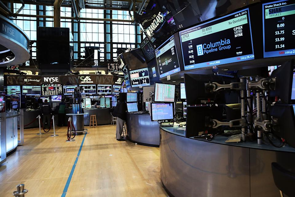 "NEW YORK, NY - JULY 08:  Traders wait on a nearly empty trading floor at the New York Stock Exchange (NYSE) after trading was halted due to a ""technical glitch"" on July 8, 2015 in New York City. Trading was to resume in the afternoon.  (Photo by Spencer Platt/Getty Images)"