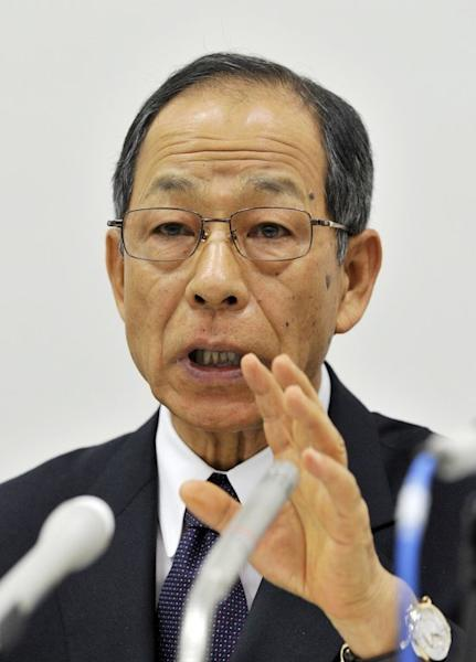 A file picture taken on October 14, 2011 shows Olympus president Tsuyoshi Kikukawa at a press conference at the Tokyo Stock Exchange. The Tokyo District Court handed Kikukawa a three-year suspended jail term for his role in a massive accounting fraud at the company