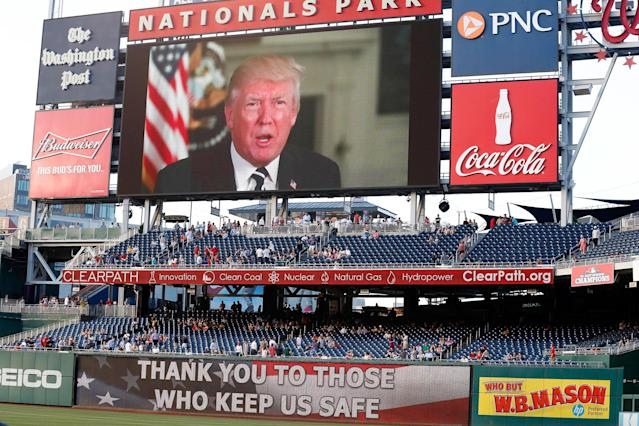 <p>A message from President Donald Trump is shown on the video board before the Congressional baseball game, Thursday, June 15, 2017, in Washington. (Photo: Alex Brandon/AP) </p>
