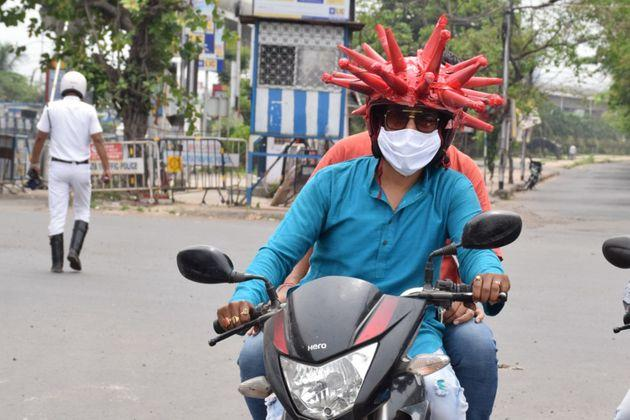 Volunteers wearing a coronavirus-themed outfit composed of helmet to raise awareness about the coronavirus in Kolkata.