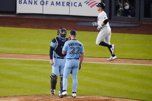 Toronto Blue Jays pitcher Chase Anderson talks to catcher Danny Jansen as New York Yankees' Brett Gardner runs the bases after hitting a two-run home run during the fourth inning of a baseball game Thursday, Sept. 17, 2020, in New York. (AP Photo/Frank Franklin II)