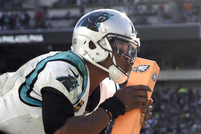 Cam Newton kisses the pylon after tripping over it while celebrating a TD pass against the Eagles in 2018. This might be too upsetting for some viewers. (AP Photo/Matt Rourke)