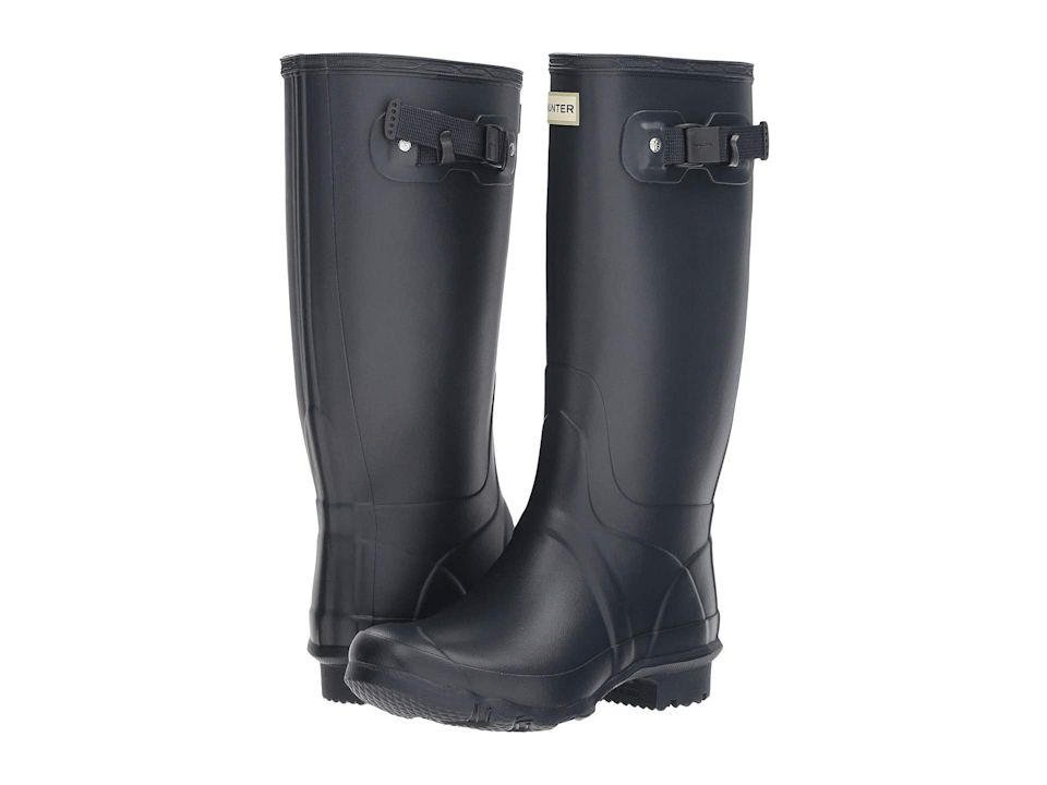 """<br><br><strong>Hunter</strong> Huntress Field Boot, $, available at <a href=""""https://go.skimresources.com/?id=30283X879131&url=https%3A%2F%2Fwww.zappos.com%2Fp%2Fhunter-huntress-field-boot-navy%2Fproduct%2F9137696%2Fcolor%2F9"""" rel=""""nofollow noopener"""" target=""""_blank"""" data-ylk=""""slk:Zappos"""" class=""""link rapid-noclick-resp"""">Zappos</a>"""