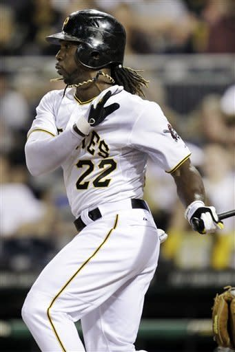 Pittsburgh Pirates' Andrew McCutchen (22) follows through on a single off Houston Astros pitcher J.A. Happ during the sixth inning of a baseball game in Pittsburgh, Saturday, May 12, 2012. McCutchen went 4 for 4 in a 5-2 Pirates win. (AP Photo/Gene J. Puskar)