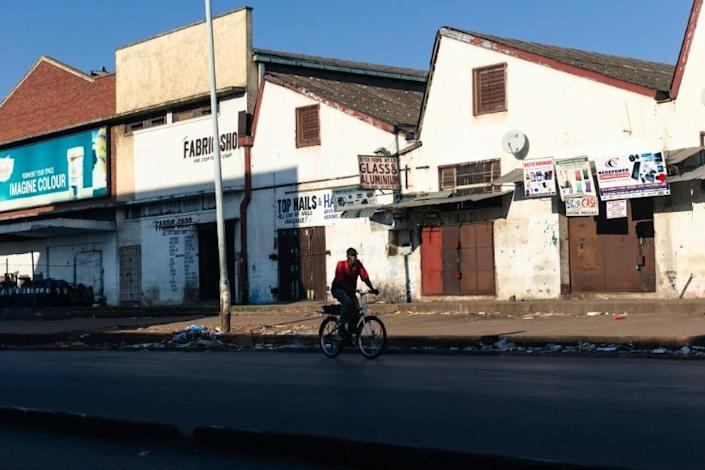 A lone cyclist makes his way in the usually bustling part of downtown Harare (AFP Photo/Jekesai NJIKIZANA)