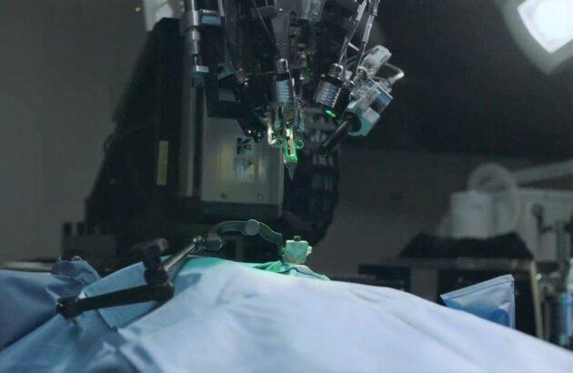Neuralink is developing an apparatus for implanting brain electrodes that has been compared to a sewing machine. (Neuralink Photo)