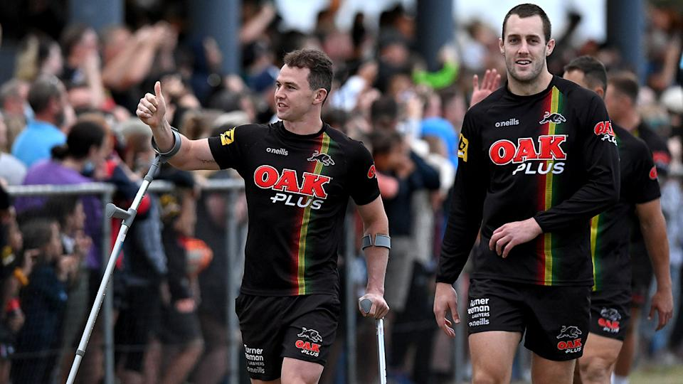 Penrith Panthers players, pictured here greeting fans at a training session at Sunshine Coast Stadium.