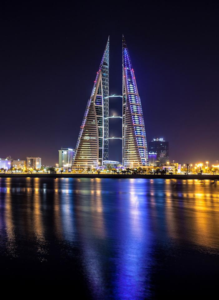 The Bahrain World Trade Center, designed by Atkins in 2008, has eco-friendly features including three skybridges holding wind turbines that generate power from strong breezes coming from the nearby Persian Gulf.