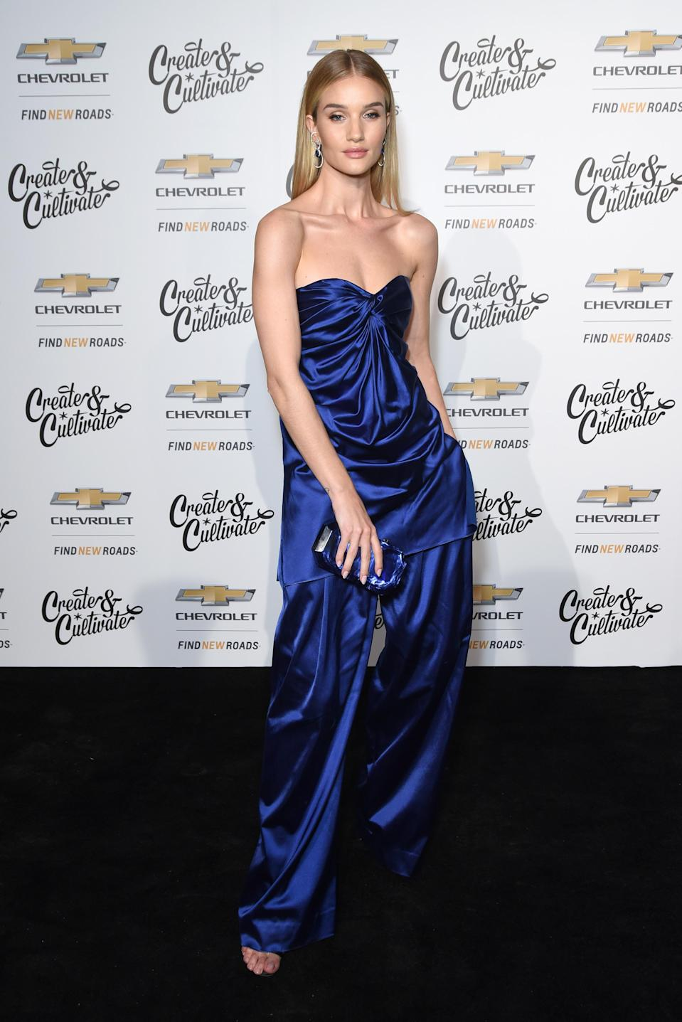 <p>On January 24, model Rosie Huntington-Whiteley seriously impressed in a midnight blue ensemble by Marina Moscone. <em>[Photo: Getty]</em> </p>