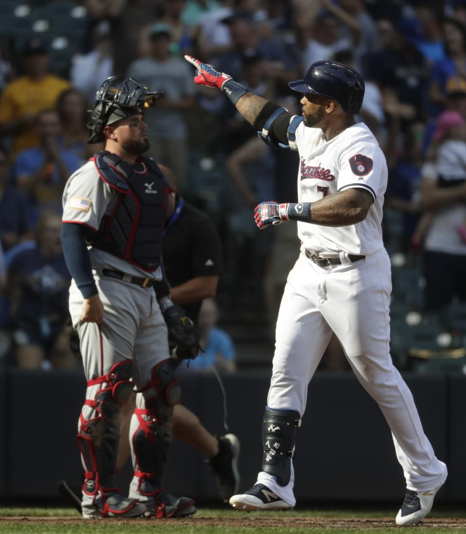 Milwaukee Brewers' Eric Thames celebrates his two-run home run during the fifth inning of a baseball game against the Minnesota Twins Tuesday, July 3, 2018, in Milwaukee. (AP Photo/Morry Gash)