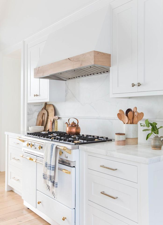"<p>Accent an all-white kitchen with brass. It feels antique-y, but definitely not dated.</p><p>See more at <a rel=""nofollow"" href=""http://amberinteriordesign.com/projects/client-for-reals-the-nicest-people-on-the-planet/"">Amber Interiors</a>.</p>"
