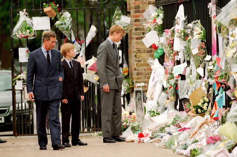 LONDON - SEPTEMBER 5: Prince Charles, Prince of Wales, his sons Prince William and Prince Harry look at floral tributes to Diana, Princess of Wales outside Kensington Palace on September 5, 1997 in London, England. (Photo by Anwar Hussein/WireImage)