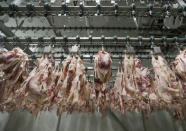 Kosher poultry meat hangs in a Kosher slaughterhouse in Csengele, Hungary on Jan. 15, 2021. The kosher slaughterhouse has increased its exports to Belgium since the European Union's highest court last month upheld a law that outlawed slaughtering animals without first stunning them into unconsciousness, and Jewish law forbids injuring an animal before it is killed.(AP Photo/Laszlo Balogh)
