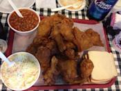 """<p><a href=""""https://www.tripadvisor.com/Restaurant_Review-g55197-d476458-Reviews-Gus_s_World_Famous_Fried_Chicken-Memphis_Tennessee.html"""" rel=""""nofollow noopener"""" target=""""_blank"""" data-ylk=""""slk:Gus's World Famous Hot & Spicy Fried Chicken"""" class=""""link rapid-noclick-resp"""">Gus's World Famous Hot & Spicy Fried Chicken</a>, Memphis</p><p>Perhaps the quintessential American fried chicken—juicy on the inside, <span class=""""entity tip_taste_match"""">crispy</span> and salty on the outside, served with a side of <span class=""""entity tip_taste_match"""">slaw</span> and <span class=""""entity tip_taste_match"""">baked beans</span> on a gingham tablecloth.<span class=""""redactor-invisible-space""""> - Foursquare user <a href=""""https://foursquare.com/purewow"""" rel=""""nofollow noopener"""" target=""""_blank"""" data-ylk=""""slk:PureWow"""" class=""""link rapid-noclick-resp"""">PureWow</a></span></p>"""