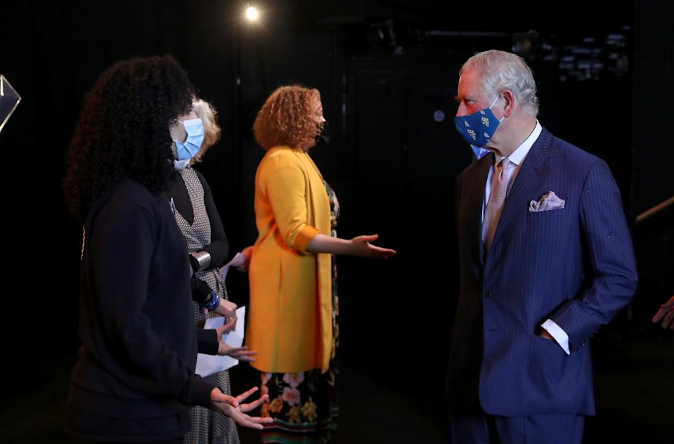 LONDON, ENGLAND - DECEMBER 03: Prince Charles, Prince of Wales (R) wears a face mask as he speaks to a performer during his visit to Soho Theatre with Camilla, Duchess of Cornwall  to celebrate London's night economy on December 03, 2020 in London, England. (Photo by Chris Jackson - WPA Pool/Getty Images)