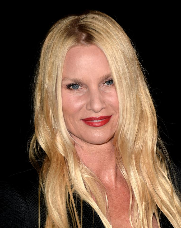 LOS ANGELES, CA - FEBRUARY 15: Actress Nicollette Sheridan arrives at the Annual Make-Up Artists and Hair Stylists Guild Awards at the Paramount Theatre on February 15, 2014 in Los Angeles, California. (Photo by Kevin Winter/Getty Images)