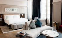 """<p>Located on the edge of London's Trafalgar Square, the Trafalgar St. James is a luxurious sanctuary within the city. Each room offers guests a relaxed and memorable stay in chic rooms designed to celebrate the modern British aesthetic. Art Deco features evoke the glamour of travel's golden age and wall art celebrates the best of London's music idols, while tactile furnishings, bold colour choices and playful ornamentation create an elegant yet welcoming feel.<br></p><p>Guests can enjoy the hotel's panoramic views from the rooftop restaurant, complete with alfresco and canopy-covered seating and outdoor heaters and blankets to cosy up with during the colder months. It's the perfect location to take in the capital - sights include The Shard, the London Eye, the Houses of Parliament, Trafalgar Square and Nelson's Column. Dine on Asian-inspired dishes, spanning grilled dishes, small plates and an impressive array of cocktails to choose from. We recommend ordering the prawn tempura, vegetable gyoza and miso cod. Of course, every meal needs a cocktail; order the Exotic Relish and you won't be disappointed. </p><p><a href=""""https://trafalgarstjames.com/"""" rel=""""nofollow noopener"""" target=""""_blank"""" data-ylk=""""slk:The Trafalgar St. James"""" class=""""link rapid-noclick-resp"""">The Trafalgar St. James</a>, prices start at £218 per night </p>"""