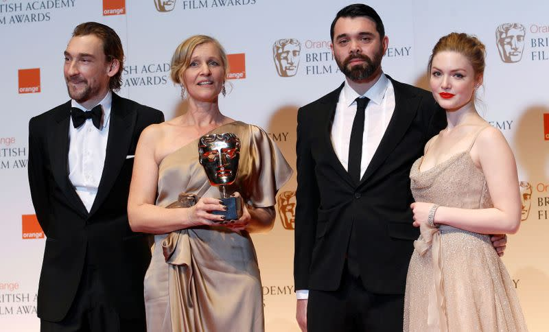 "FILE PHOTO: Winners of the Short Animation award for ""A Morning Stroll"" Orchard and Goffe, pose with presenters Mawle and Grainger at the BAFTA awards ceremony in London"