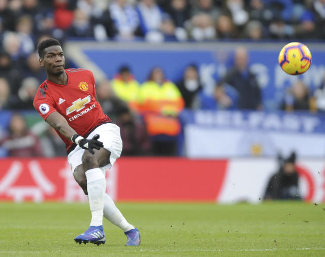Manchester United's Paul Pogba kicks the ball during the English Premier League soccer match between Leicester City and Manchester United at the King Power Stadium in Leicester, England, Sunday, Feb 3, 2019. (AP Photo/Rui Vieira)