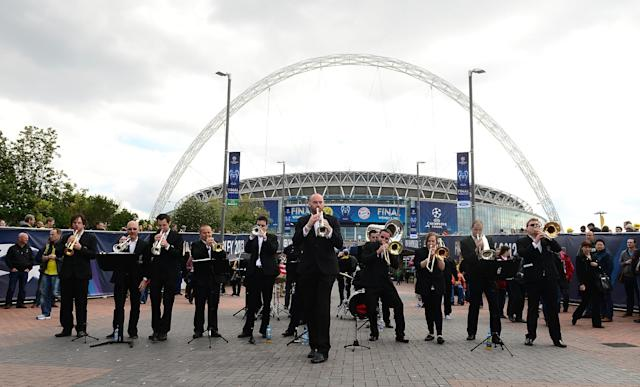 A trumpet band plays outside Wembley Stadium before the game.
