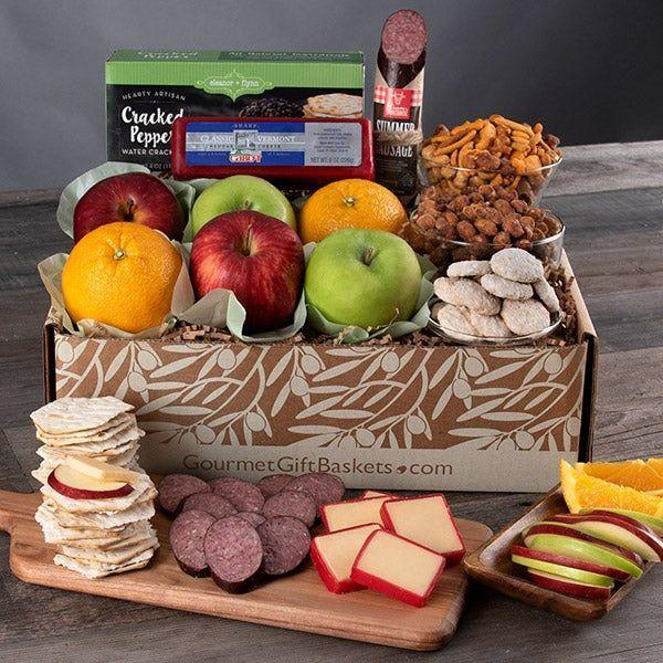 """<p><strong>GourmetGiftBaskets.com</strong></p><p>gourmetgiftbaskets.com</p><p><strong>$69.99</strong></p><p><a href=""""https://go.redirectingat.com?id=74968X1596630&url=https%3A%2F%2Fwww.gourmetgiftbaskets.com%2FFarmers-Market-Gift-Box.asp&sref=https%3A%2F%2Fwww.thepioneerwoman.com%2Fholidays-celebrations%2Fgifts%2Fg37433020%2Ffood-gift-baskets%2F"""" rel=""""nofollow noopener"""" target=""""_blank"""" data-ylk=""""slk:Shop Now"""" class=""""link rapid-noclick-resp"""">Shop Now</a></p><p>Gift someone special the farmers market experience with this bestselling box. Its variety can't be beat—it comes with assorted fruits, crackers, cheddar cheese, summer sausage, roasted and salted pistachios, and more.</p>"""
