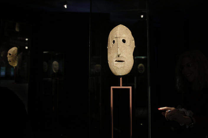 """In this Monday, March 10, 2014 photo, 9,000 year-old masks are on display at the Israel Museum in Jerusalem. The exhibition called """"Face To Face"""" shows eleven stone masks, said to have been discovered in the Judean desert and hills near Jerusalem, which date back 9,000 years and offer a rare glimpse at some of civilization's first communal rituals. (AP Photo/Tsafrir Abayov)"""