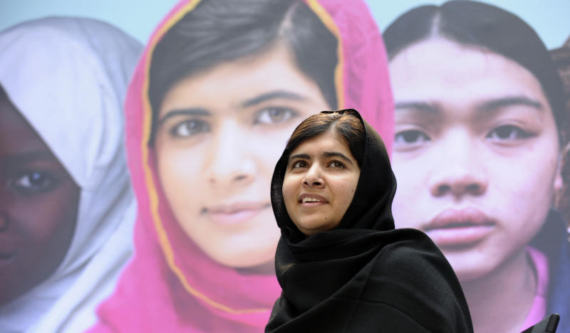 """FILE - In this Oct. 11, 2013, file photo Malala Yousafzai, the 16-year-old girl from Pakistan, who was shot in the head by the Taliban last October for advocating education for girls, speaks on occasion of the International Day of the Girl at the World Bank in Washington. Malala has inspired the development of school curriculum encouraging advocacy. George Washington University announced Monday, Oct. 14, that faculty members are creating curriculum tools to accompany her book, """"I Am Malala."""" Several faculty members will pilot the curriculum early next year for both college and high school instruction. (AP Photo/Susan Walsh)"""