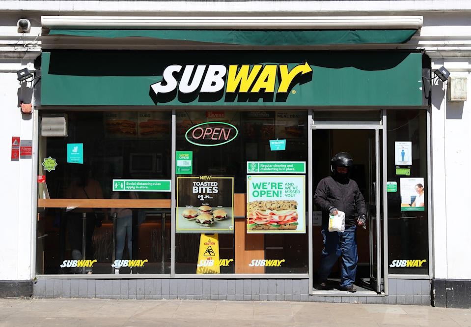 AYLESBURY, ENGLAND  - JUNE 05: A Deliveroo driver collects a takeaway order from Subway on June 05, 2020 in Aylesbury, England . The British government further relaxed Covid-19 quarantine measures in England this week, allowing groups of six people from different households to meet in parks and gardens, subject to social distancing rules. Many schools also reopened and vulnerable people who are shielding in their homes are allowed to go outside again. (Photo by Catherine Ivill/Getty Images)