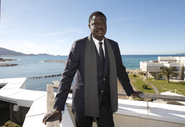 FILE - In this Feb.4, 2014 file photo, former president of Olympic Marseille soccer club, Pape Diouf, poses after a press conference, in Marseille, southern France. Pape Diouf, who led the French soccer club from 2005-09, has died after contracting the coronavirus. He was 68. (AP Photo/Claude Paris, File)