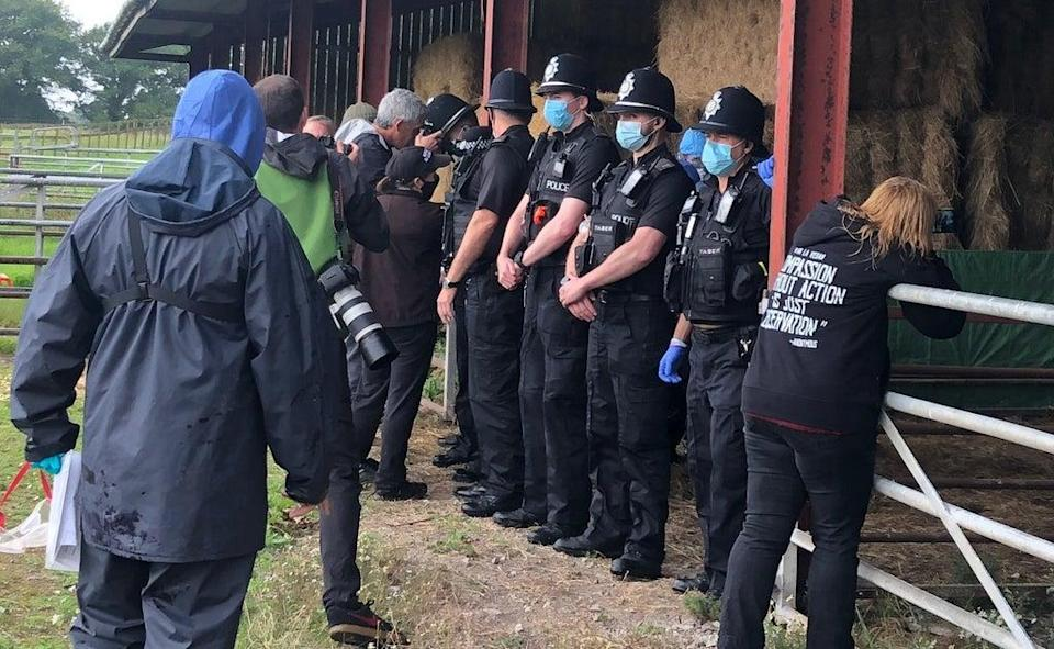 Officers screen workers who arrived with a police escort (Claire Hayhurst/PA) (PA Wire)