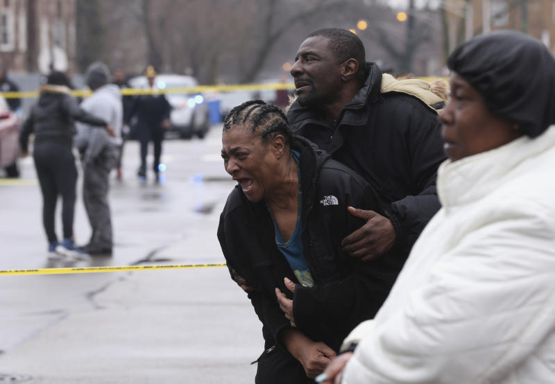Georgia Jackson, 72, is overcome with emotion upon learning that her two grandsons, Raheem, 19, and Dillon Jackson, 20, were found fatally shot in the South Shore neighborhood in Chicago on Thursday, March 30, 2017. Chicago police said Thursday several people were found fatally shot Thursday in or near a restaurant. (Chris Sweda/Chicago Tribune via AP)