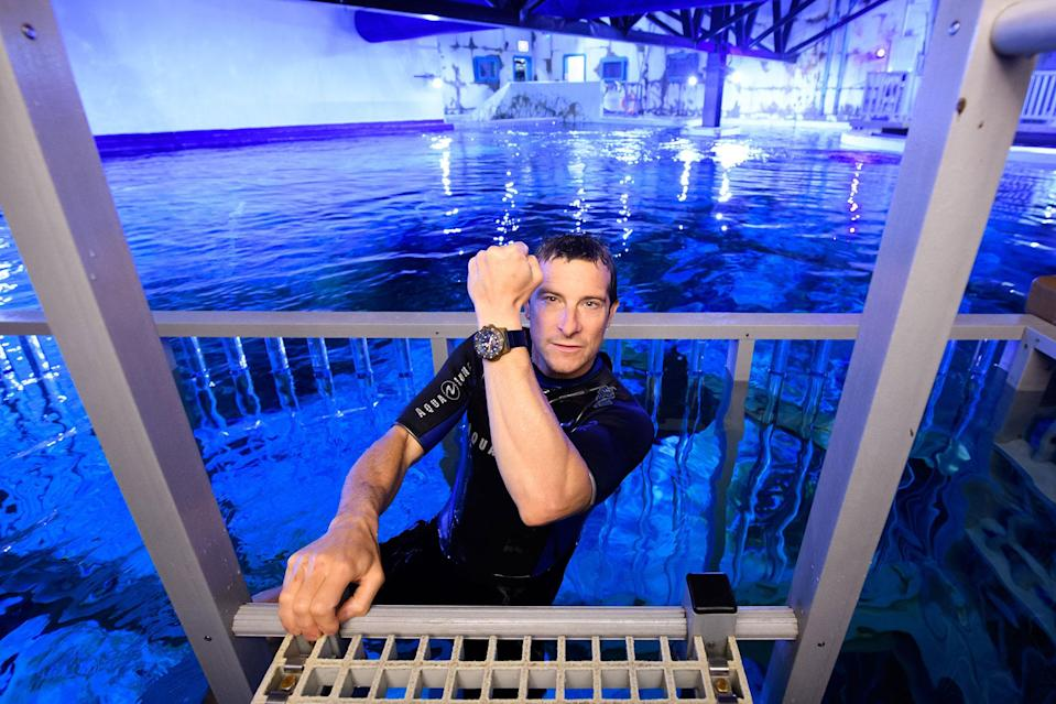 <p>Bear Grylls takes a dip in the tank filled with sharks, rays and tropical fish at The Bear Grylls Adventure in Birmingham, England, on Saturday.</p>