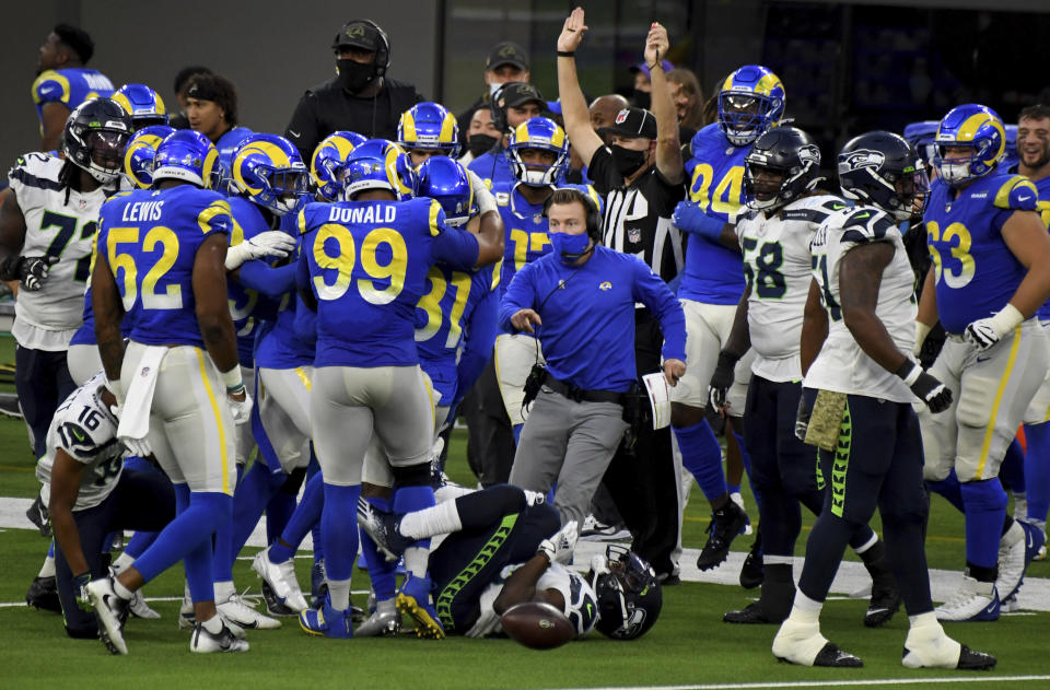Los Angeles Rams head coach Sean McVay, right, reacts after defensive back Darious Williams (31) intercepted a pass intended for Seattle Seahawks tight end Greg Olsen (88) in the fourth quarter of an NFL football game in Inglewood, Calif., Sunday, Nov. 15, 2020. (Keith Birmingham/The Orange County Register via AP)