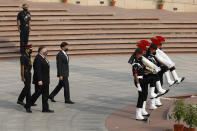 U.S. Secretary of State Mike Pompeo and Secretary of Defence Mark Esper arrive to pay their tributes at the National War Memorial in New Delhi, India, Tuesday, Oct. 27, 2020. In talks on Tuesday with their Indian counterparts, Pompeo and Esper are to sign an agreement expanding military satellite information sharing and highlight strategic cooperation between Washington and New Delhi with an eye toward countering China. (Adnan Abidi/Pool via AP)