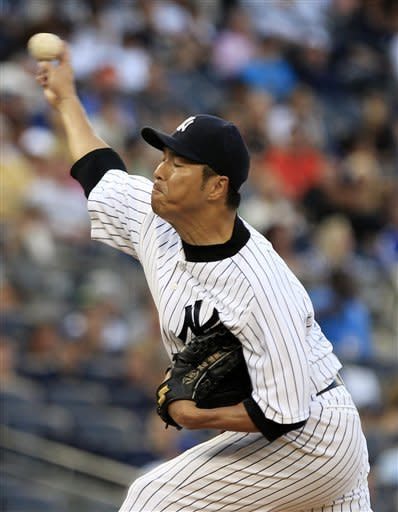 New York Yankees' Hiroki Kuroda, of Japan, delivers a pitch during the second inning of an interleague baseball game against the New York Mets on Friday, June 8, 2012, in New York. (AP Photo/Frank Franklin II)