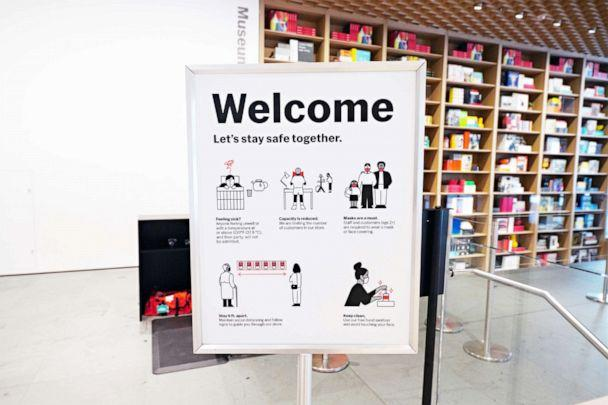 PHOTO: The Museum of Modern Art prepares to reopen to the public on Aug. 27 by displaying specially commissioned 'Let's Stay Safe Together' graphic illustrations on Aug. 20, 2020, in New York City. (Cindy Ord/Getty Images)