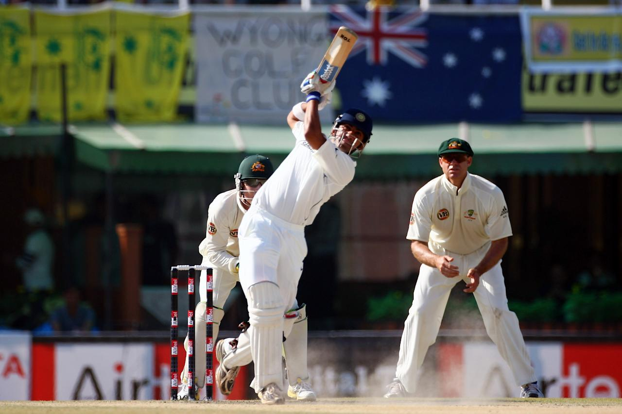 MOHALI, INDIA - OCTOBER 20: Gautam Gambhir of India hits a six off the bowling of Cameron White of Australia during day four of the Second Test match between India and Australia at the Punjab Cricket Association Stadium on October 20, 2008 in Mohali, India.  (Photo by Michael Steele/Getty Images)